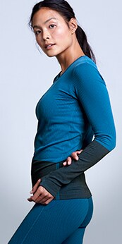 woman wearing a long sleeve cobalt blue flurry cold training top