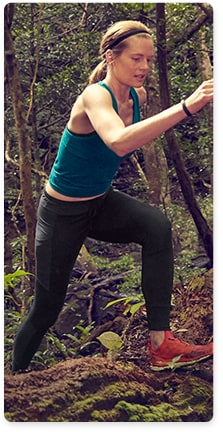 woman wearing teal tank top and black hiking pants
