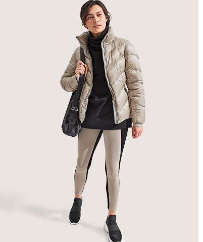 woman in tan lofty down jacket