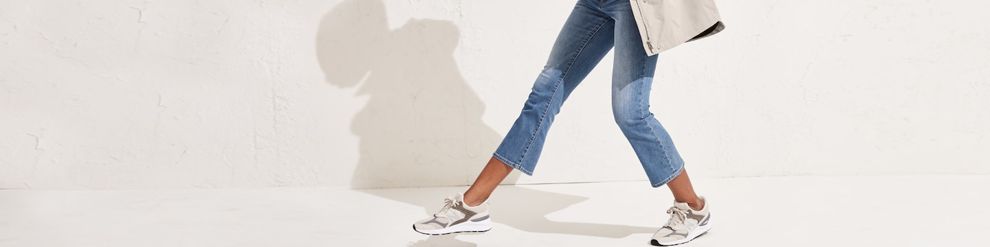 woman striding in sculptek denim