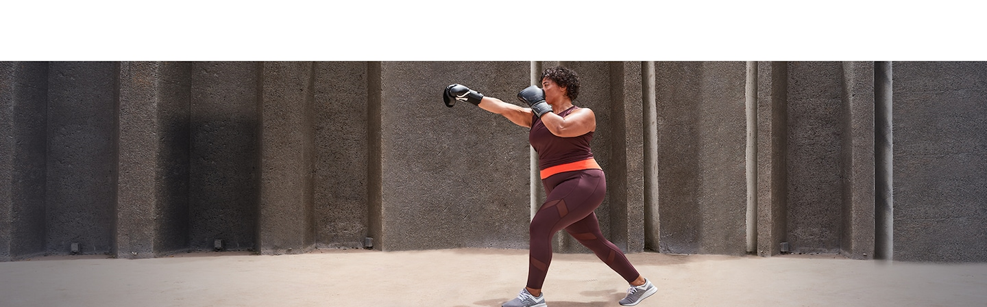 woman boxing in maroon in the tenacity 7/8 tight