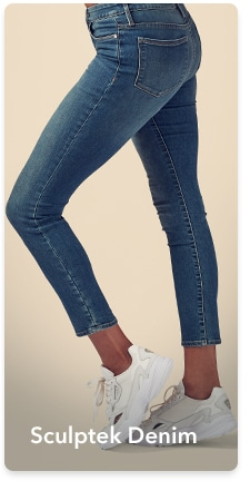 woman in cropped medium wash sculptek denim