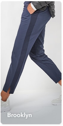 woman in blue brooklyn pant with black stripe