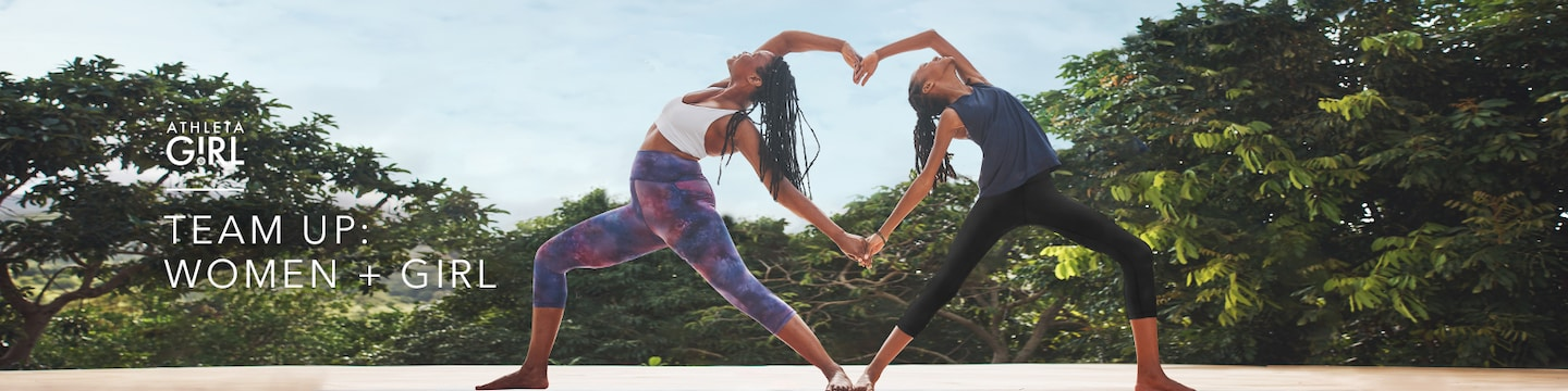 mother and daughter doing yoga together