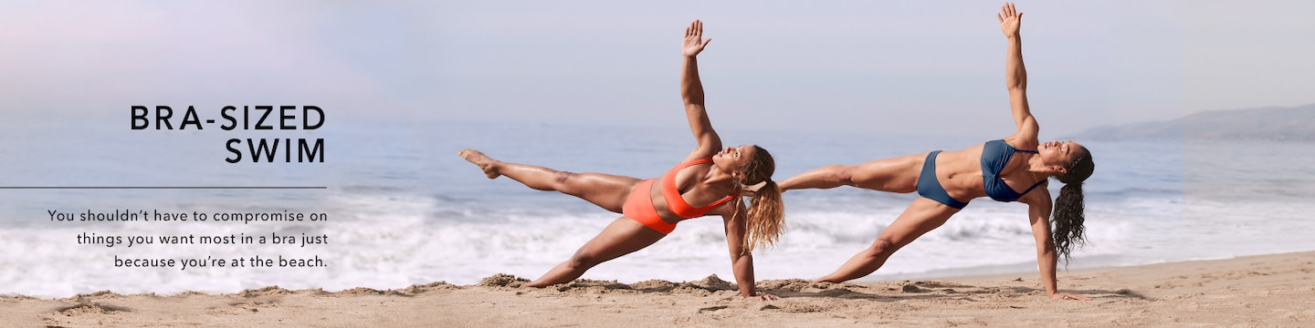 women doing yoga on the beach in bra-sized bikinis